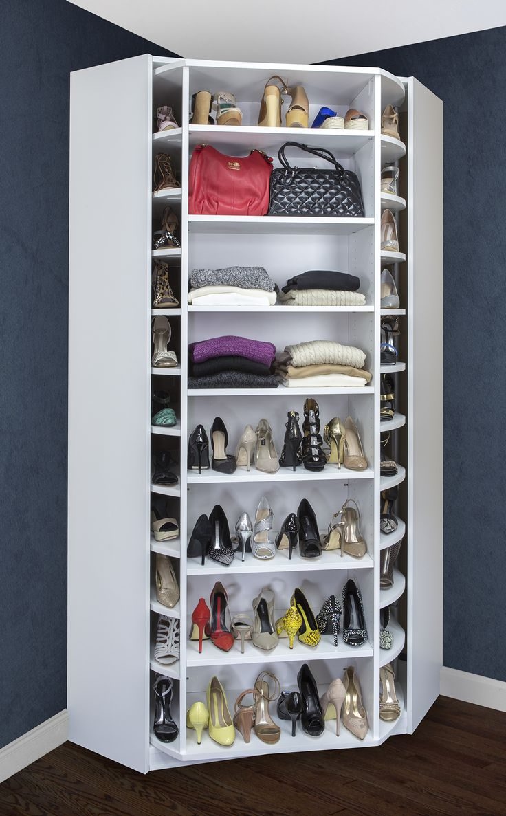 a corner shoe cabinet with shoes and bag shelves that are rotating to give you evne more storage space