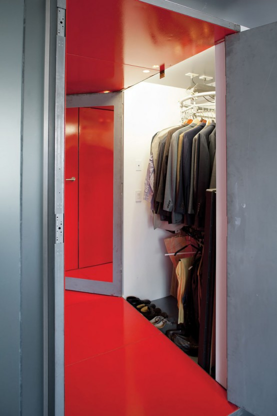 a small and well-organized closet with shoes and clothes, lots of clothes hangers, and rotating shelves to accommodate more