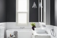 a simple cone-like sheer glass pendant lamp perfectly matches the style of the bathroom and colors