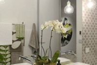 bulb-shaped sheer glass pendant lamps over the vanity for a touch of light and cool shapes are perfect