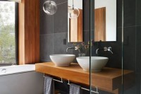 sheer glass bubble pendant lamps over the vanity will accent the space gently and will add to the style