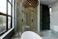 an arrangement of laser cut pendant lamps of various shapes is a stunning accent for the bathing zone