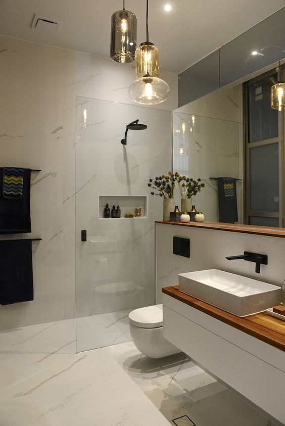 25 creative modern bathroom lights ideas you ll love for Modern small ensuite
