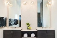 3D pendant lamps over the vanity are a cool idea that will bring an edgy feel to the space