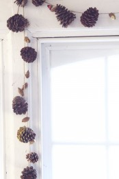 a fall garland of larger and smaller pinecones and dried blooms is a cool idea for rocking in any space in the fall