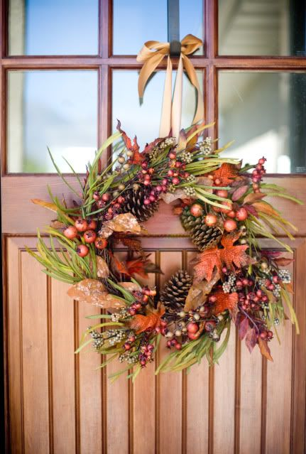 a bright fall wreath of grasses, bold leaves, pinecones, berries, acorns and other elements to style your front door