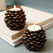 gilded pinecones turned candleholders are cool decorations to go for, you can DIY as many as you like