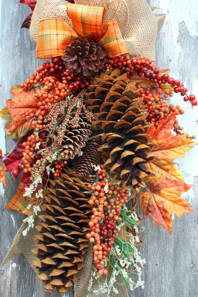 a fall decoration of large pinecones, leaves and berries and bright plaid and burlap bows will bring a bold touch to your space