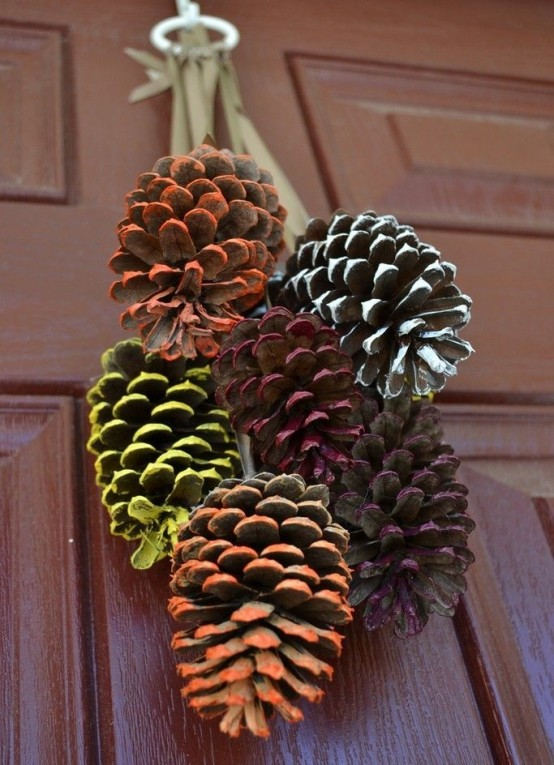 a decoration composed of bright painted pinecones is a bright and fun idea for the fall