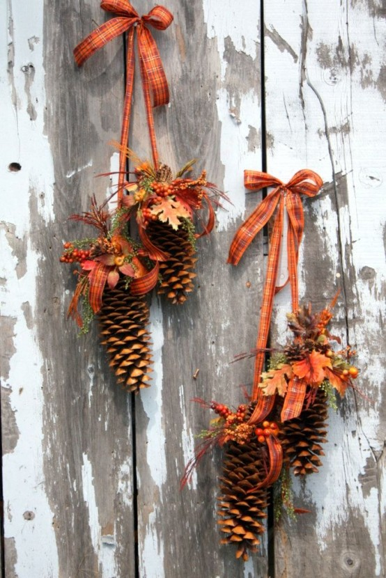 fall posies made of hanging pinecones and faux blooms, berries and orange plaid ribbons feel like fall itself