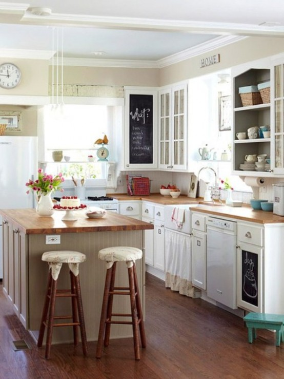 a small and cozy farmhouse kitchen with white cabinets and wooden countertops, stools and lots of natural light