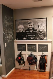 an oversized black and white photo in a black frame attached over a bag rack is a lovely decoration