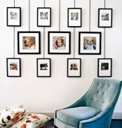 a catchy gallery wall with family photos in three rows with larger and smaller photos is a chic idea