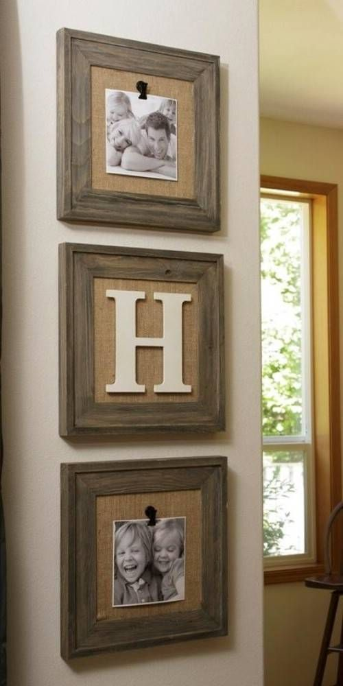 a rustic mini display with photos attached to burlap and framed with stained frames is a chic idea with a cozy feel