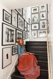 cover your staircase walls with black and white photos in matching frames creating a stylish display with a meaning