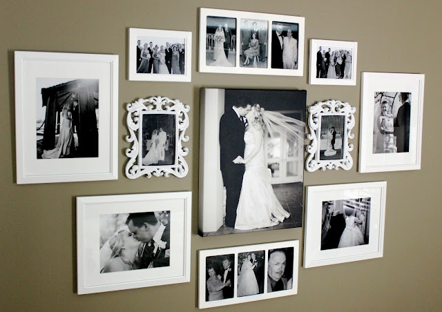 an elegant gallery wall with black and white photos in vintage white frames and without frames is stylish