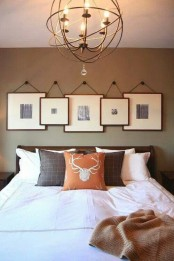 black and white photos in matching frames over the headboard hanging on each other forming a cool gallery wall
