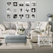 an elegant gallery wall with black and white photos framed in white is a stylish idea to rock