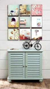 a stylish gallery wall with cool photos on cubes attached to the wall with no frames is a cool idea