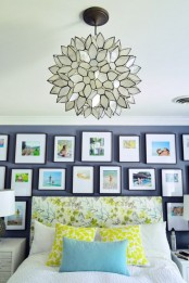 a bright gallery wall with color pics in matching black frames over the bed to make the space bolder and cooler