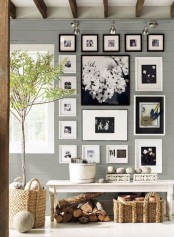an elegant gallery wall with black and white photos in black and white frames is a stylish decoration for your home