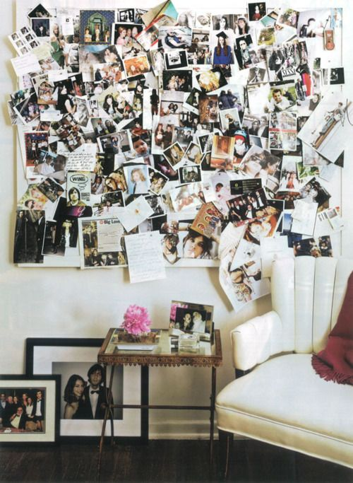 a memoboard with lots of photos chaotically attached to it is a very bright eclectic decoration for any space