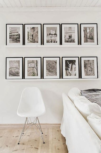 white ledges with black and white photos in black frames is a very stylish decoration for any contemporary space