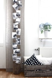 a wooden beam with lots of black and white photos from holidays will inspire you and fill with good memories