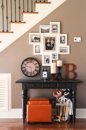 a stylish vintage-inspired gallery wall with black and white photos in white frames is elegant and chic