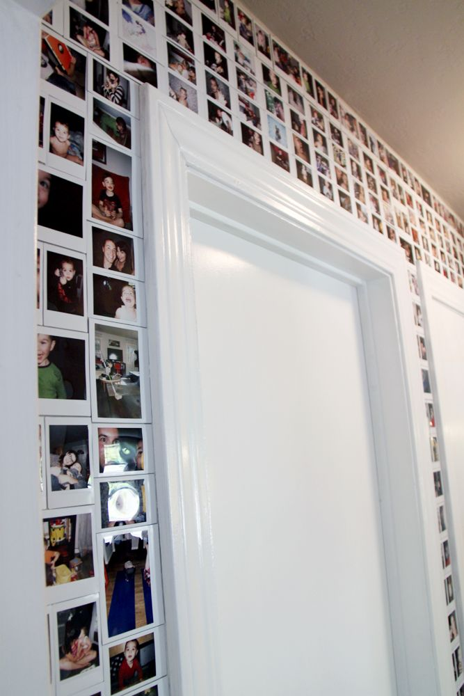 a doorway covered with Polaroids above and around it is a cool decor idea to enjoy your favorite pics