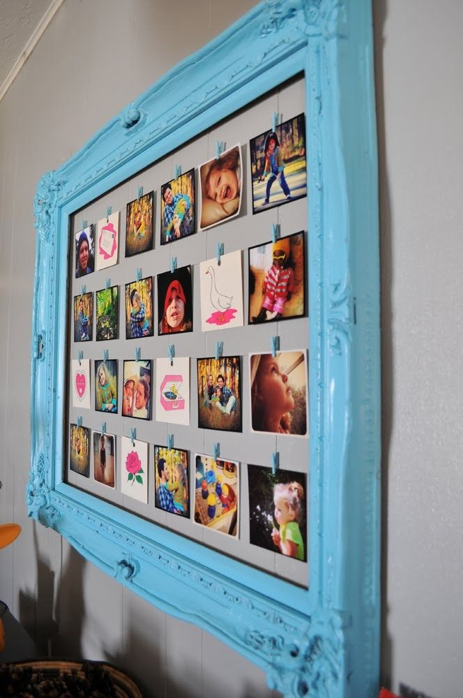 a vintage blue frame with wire and colorful photos attached with clothespins is an elegant and refined decor idea
