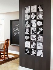 an awkward wall taken by a black and white gallery wall with unframed photos hanging in three rows is a new accent in the space