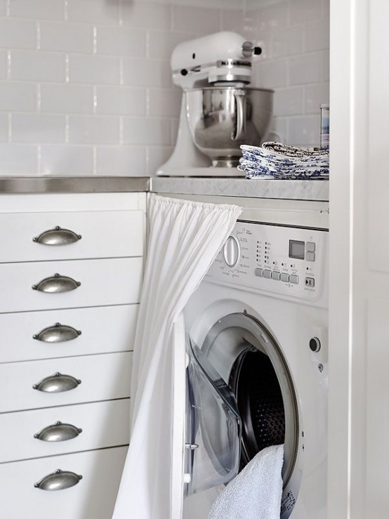 A curtain can hide a washing machine if it doesn't fully fit a kitchen cabinet.