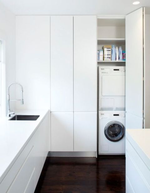 Stacking a washing machine and a dryer is a great way to fit them in a narrow but tall cabinet.