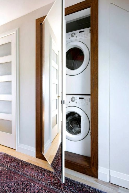 A narrow walk-in closet could fit both a washing machine and a dryer stacked on each other.
