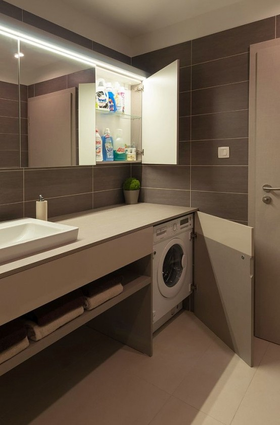 The first room that comes in mind when you want to hide a washer in is a bathroom.