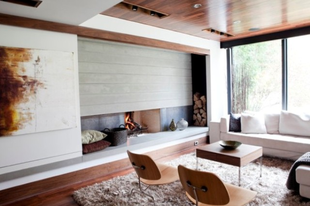 store your firewood next to the fireplace, in a niche on one side, this is a very modern and cool idea to hide it