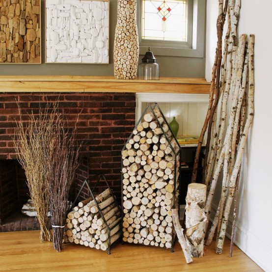 firewood and branch storage units shaped as little houses are cool and cozy to add a bit of rustic feel to the space