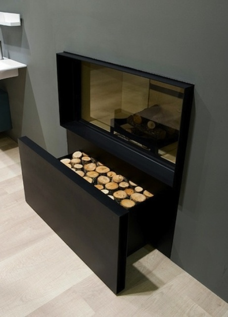 a minimalist built in fireplace with a drawer for firewood under it is a stylish and cool idea for a modern space and is very laconic