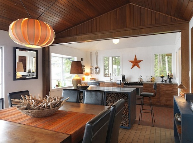 a kitchen island holding firewood is a fantastic idea for a fireplace or a hearth, it adds a cozy touch to the space