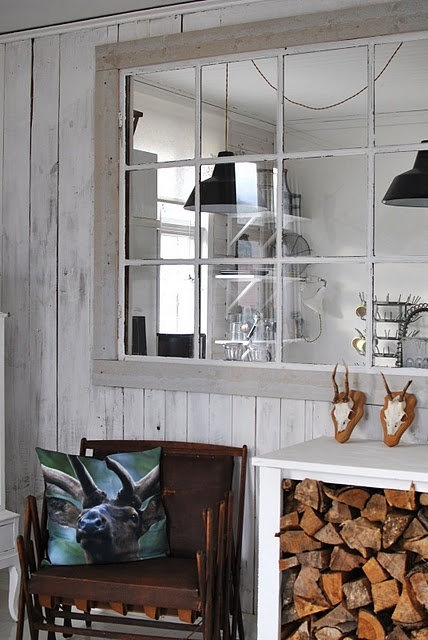 a console table with firewood stored inside is a very cozy rustic idea for any kind of space