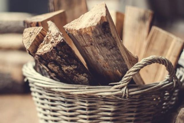 a basket with firewood is a lovely idea for any space, it will add coziness and a rustic feel to the room