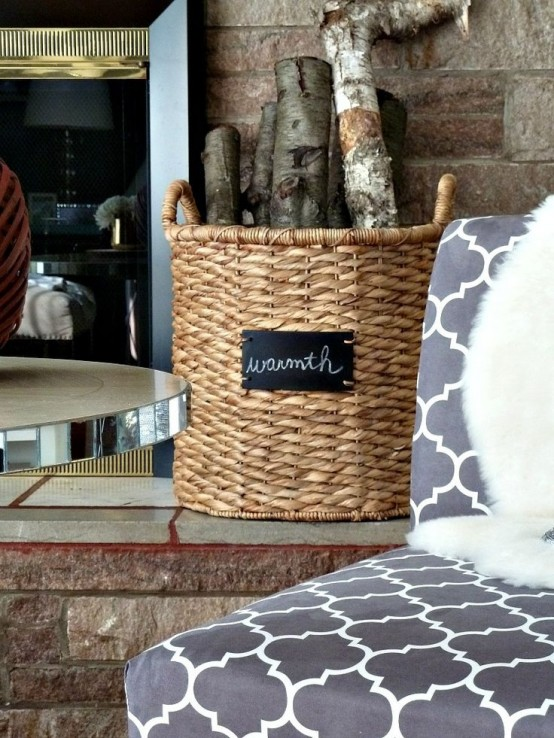 a basket with firewood by a fireplace will add coziness and warmth to any space and will make it cooler