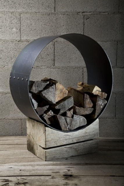 a cool modern firewood stand of a rough piece of wood and a metal circle that holds firewood is a very bold idea