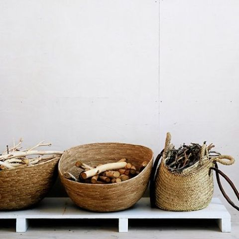 a number of baskets for storing wood and branches will add a relaxed and natural feel to the space