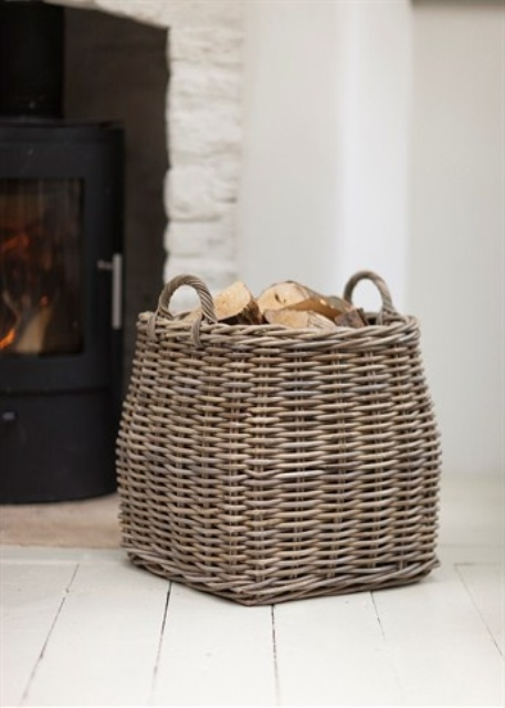 a basket with firewood by the fireplace is a cool idea for literally any space and will add a bit of coziness