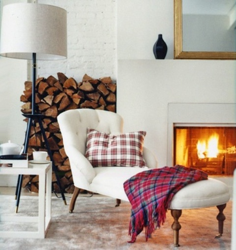 a fireplace and some firewood stored by its side is a great idea for many modenr interiors