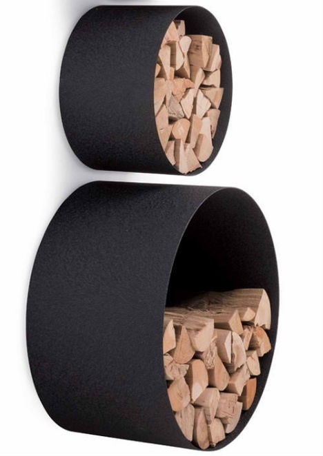 black metal round storage units can be attached to the wall and used not only for firewood storage but also for other stuff, too