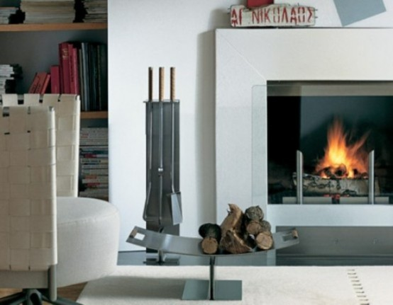 an elegant metal stand for firewood is mobile and can be placed closer to the fireplace or somewhere else and looks very minimal