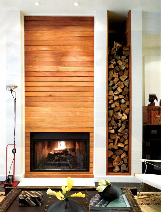 a built-in fireplace and a niche for firewood next to it add warmth and coziness to the space